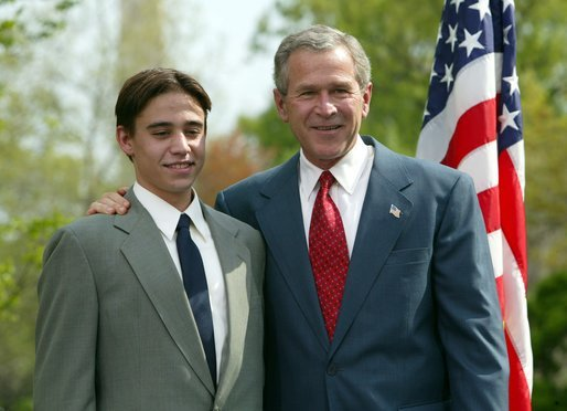 President George W. Bush congratulates Benjamin Banwart, 18, of Shakopee, Minn., on receiving the President's Environmental Youth Award in the East Garden April 22, 2004. White House photo by Susan Sterner.