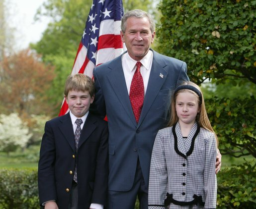 President George W. Bush congratulates siblings Alexander, 10, and Sara Reid, 8, of Central Elementary School of Belmont, Calif., on receiving the President's Environmental Award in the East Garden April 22, 2004. White House photo by Susan Sterner.