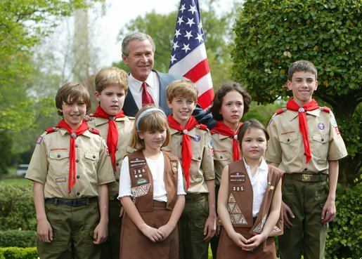 President George W. Bush congratulates the Dodge Elementary Scouts for Wetland Habitat Enhancement of East Amherst, N.Y., on receiving the President's Environmental Youth Award in the East Garden April 22, 2004. White House photo by Susan Sterner.