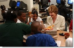 Laura Bush attends a class with middle school students during Mrs. Hatty Drew's reading lab at the Snowden School in Memphis, Tenn. Friday, April 23, 2004.  White House photo by Tina Hager
