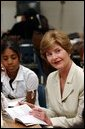 Laura Bush reads Mrs. Frisby and the Rats of Nimh with middle school students during Mrs. Hatty Drew's reading lab at the Snowden School in Memphis, Tenn. Friday, April 23, 2004. White House photo by Tina Hager.