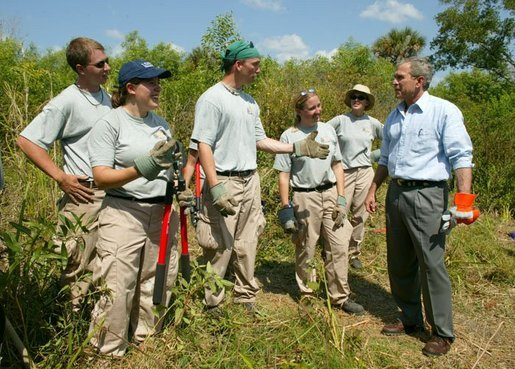 "President George W. Bush talks with AmeriCorps volunteers at Rookery Bay National Estuarine Research Reserve in Naples, Fla., Friday, April 22, 2004. ""Here at Rookery Bay, you see how important wetlands are to protecting 150 species of birds, and many threatened and endangered animals,"" said the President in his remarks. White House photo by Eric Draper"