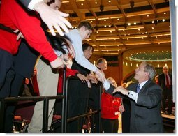 President George W. Bush greets the crowd after giving remarks to the American Associations of Community Colleges annual convention in Minneapolis, Minn., Monday, April 26, 2004.  White House photo by Paul Morse