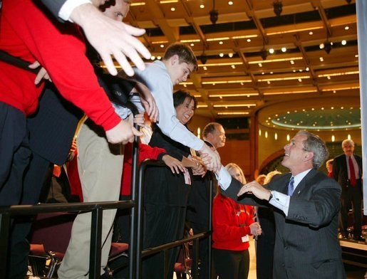 President George W. Bush greets the crowd after giving remarks to the American Associations of Community Colleges annual convention in Minneapolis, Minn., Monday, April 26, 2004. White House photo by Paul Morse.