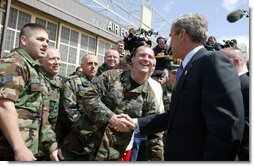 President George W. Bush greets base personnel of the 934th Airlift Wing of the Air National Guard at Minneapolis-St. Paul International Airport in Minneapolis, Minn., Monday, April 26, 2004.  White House photo by Paul Morse