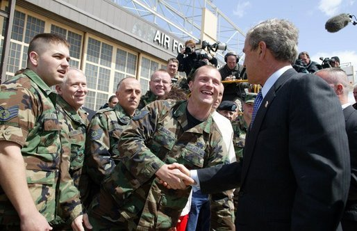President George W. Bush greets base personnel of the 934th Airlift Wing of the Air National Guard at Minneapolis-St. Paul International Airport in Minneapolis, Minn., Monday, April 26, 2004. White House photo by Paul Morse.