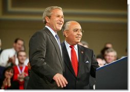 "President George W. Bush is introduced by Jesus Carreon before giving remarks to the American Associations of Community Colleges annual convention in Minneapolis, Minn., Monday, April 26, 2004. ""Jess told me coming in here that -- I asked him where he was raised. He said, Southern California,"" commented the President before his remarks. ""He said he didn't speak English when he came to America at age five. His dad had big dreams for him. And here he is, years later, introducing the President of the United States in perfect English.""  White House photo by Paul Morse"