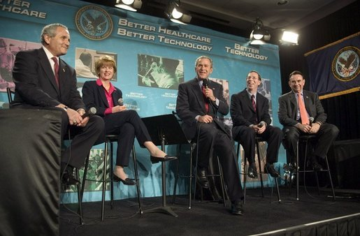 President George W. Bush participates in a conversation on the benefits of health care information technology with, from left, Anthony Principi, Secretary of Veterans Affairs, Marlene Miller, M.D. of John Hopkins Children's Center, Dennis Smith of VA Maryland Health Care System and Tommy Thompson, Secretary of Health and Human Services at the Department of Veterans Affairs Medical Center in Baltimore, Maryland on April 27, 2004. White House photo by Paul Morse