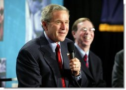 President George W. Bush participates in a conversation on the benefits of health care information technology with Dennis Smith of VA Maryland Health Care System at the Department of Veterans Affairs Medical Center in Baltimore, Maryland on April 27, 2004.  White House photo by Paul Morse