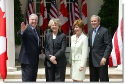 President George W. Bush and Mrs. Laura Bush with Canadian Prime Minister Paul Martin and his wife Sheila Martin after responding to questions from the press corps in the Rose Garden of the White House on April 30, 2004.  White House photo by Paul Morse