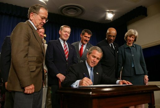 President George W. Bush signs into effect the Indian Education Executive Order in Room 450 of the Old Executive Building on April 30, 2004. White House photo by Paul Morse
