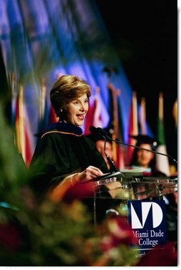 "Laura Bush addresses the graduates of Miami Dade College in Miami, Fla., Saturday, May 1, 2004. ""We're inspired by these stories of hope and progress. And I am inspired by each of your stories. Many commencement speakers try to give some grand life advice. But I don't have to do that for you. You are the advice I would give to others. But if you remember one thing, I hope it's this -- never cease to learn. Don't simply read books, devour them, and share them. In your wallet, put your library card before your credit card.""  White House photo by Tina Hager"