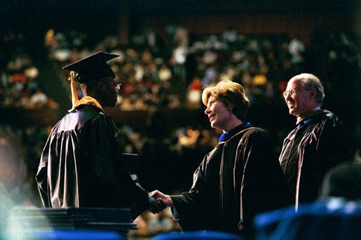 Laura Bush congratulates a graduate from the Class of 2004 of Miami Dade College in Miami, Fla., Saturday, May 1, 2004. White House photo by Tina Hager