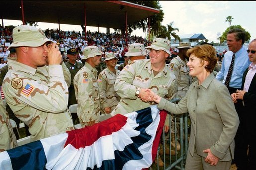 "Laura Bush thanks the men and women of the United States Military and the National Guard and Reserves for their service to our Nation during her remarks in Winter Haven, Fla., Saturday, May 1, 2004 ""You are the face of American compassion abroad. You will have a greater impact than you can ever imagine on people that you will only know for a brief time. But you have delivered the greatest gift they will ever know -- you've sacrificed your own comfort, your own safety, and your own lives so that others might know freedom."" White House photo by Tina Hager"