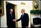 President George W. Bush welcomes Prime Minister Goh Chok Tong of Singapore to the Oval Office Wednesday, May 5, 2004.  White House photo by Eric Draper