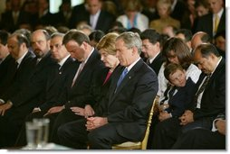 "President George W. Bush and Laura Bush bow their heads in prayers during a White House ceremony honoring Cinco de Mayo in the East room Wednesday, May 5, 2004. ""Mexican Americans have brought many strengths to our nation: a culture built around faith in God, a deep love for family, a belief that hard work leads to a better life,"" said the President in his remarks. ""Every immigrant who lives by these values makes our country better and makes our future brighter.""  White House photo by Paul Morse"