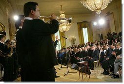 President George W. Bush listens to Banda El Recodo during a White House ceremony honoring Cinco de Mayo in the East room Wednesday, May 5, 2004. Mexican recording artists Marco Antonio Solis and Jimena also performed during the event.   White House photo by Paul Morse