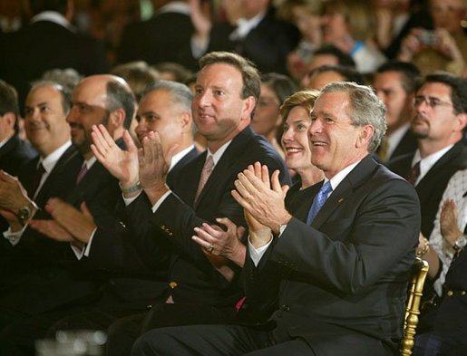 "Sitting with the U.S. Ambassador to Mexico Tony Garza, President George W. Bush and Laura Bush applaud the performances during a White House ceremony honoring Cinco de Mayo in the East room Wednesday, May 5, 2004. ""The great triumph of Mexican forces on May the 5th, 1862, has inspired liberty-loving people everywhere, and it's helped shape the character of modern Mexico,"" said the President remarked on the history of the date. ""Against great odds, a small and under-equipped army defeated the skilled army of a European power. We've had that experience in America, too."" White House photo by Paul Morse"