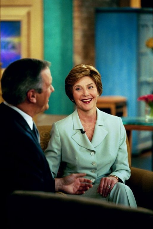 Laura Bush speaks with Charlie Gibson during a Good Morning America live interview at the ABC Studios in New York City, Monday, May 10, 2004. White House photo by Tina Hager