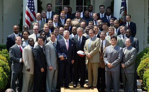 President George W. Bush with the Super Bowl Champion New England Patriots and owner Bob Kraft and coach Bill Belichick during a photo opportunity in the Rose Garden on May 10, 2004. White House photo by Paul Morse