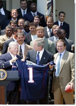 President George W. Bush receives a jersey from New England Patriots owner Bob Kraft and coach Bill Belichick during a photo opportunity with the Super Bowl champions in the Rose Garden on May 10, 2004.  White House photo by Paul Morse