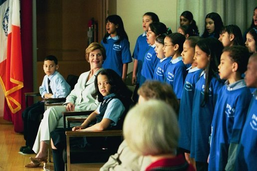 Laura Bush listens to the choir of the P.S. 92 Harry T. Stewart School in Corona, N.Y., during a grant presentation by the Laura Bush Foundation for America's Libraries Monday, May 10, 2004. White House photo by Tina Hager