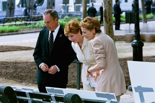 "Laura Bush views drawings for the ""Gardens of Remembrance,"" a September 11th memorial, with Mrs. Warrie Price, Founder and President of The Battery Conservancy, and New York City Mayor Michael Bloomberg in New York's Battery Park Monday, May 10, 2004. White House photo by Tina Hager"