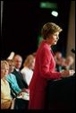 "Laura Bush delivers remarks at the Tenth Anniversary of the Annual Prayer Breakfast honoring the National Day of Prayer in Albany, N.Y., Tuesday, May 11, 2004. ""God has blessed our nation and our lives beyond measure. And today we pray that God will grant us the courage and the conviction to celebrate our faith, to serve others, and to seek comfort in prayer,"" said Mrs. Bush. ""This is our prayer for all Nations and for all of God's people."" White House photo by Tina Hager"
