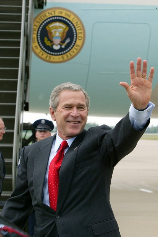 President George W. Bush waves to the crowd upon his arrival to Fort Smith, Ark., Tuesday, May 11, 2004. White House photo by Paul Morse
