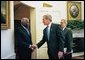 President George W. Bush welcomes President Jose Eduardo dos Santos of Angola to the Oval Office Wednesday, May 12, 2004. White House photo by Eric Draper