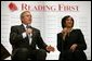 President George W. Bush participates in a conversation on Reading First and the No Child Left Behind Act with kindergarten teacher Cynthia Henderson at the National Institutes of Health in Bethesda, Maryland on May 12, 2004. White House photo by Paul Morse