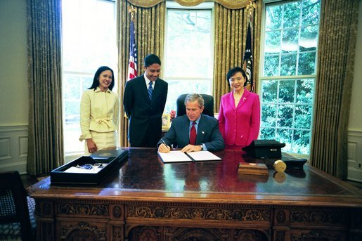 President George W. Bush signs an executive order creating the new President's Advisory Commission on Asian Americans and Pacific Islanders. Pictured with the President are, from left, Susan Ralston, Executive Assistant to the Senior Advisor; Eddy Badrina, director, White House Initiative on Asian Americans and Pacific Islanders; and Chiling Tong, associate director, Office of Legislative, Education and Intergovernmental Affairs, Minority Business Development Agency. The new Commission will be housed at the Department of Commerce in the Minority Business Development Agency and will focus on providing equal economic opportunities for Asian American and Pacific Islander businesses where they may be underserved. White House photo by Eric Draper.