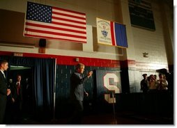 President George W. Bush salutes law enforcement officers before participating in a conversation on High School Initiatives at Parkersburg South High School in Parkersburg, W. Va., Thursday, May 13, 2004.  White House photo by Paul Morse