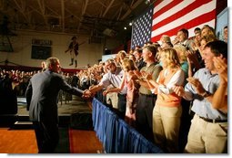 President George W. Bush greets the audience before participating in a conversation on High School Initiatives at Parkersburg South High School in Parkersburg, W. Va., Thursday, May 13, 2004.  White House photo by Paul Morse