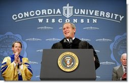 President George W. Bush is greeted with cheers as he begins his address at the commencement ceremonies for Concordia University near Milwaukee, Wis., Friday, May 14, 2004.  White House photo by Paul Morse