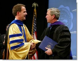 President George W. Bush is congratulated upon receiving an honorary doctorate degree during the commencement ceremonies for Concordia University near Milwaukee, Wis., Friday, May 14, 2004.  White House photo by Paul Morse