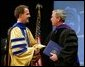 President George W. Bush is congratulated upon receiving an honorary doctorate degree during the commencement ceremonies for Concordia University near Milwaukee, Wis., Friday, May 14, 2004. White House photo by Paul Morse.
