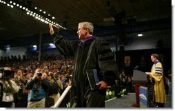 President George W. Bush waves to the audience after being awarded an honorary doctorate degree from Dr. Patrick Ferry at the commencement ceremonies for Concordia University near Milwaukee, Wis., Friday, May 14, 2004.  White House photo by Paul Morse