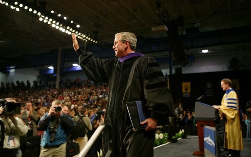 President George W. Bush waves to the audience after being awarded an honorary doctorate degree from Dr. Patrick Ferry at the commencement ceremonies for Concordia University near Milwaukee, Wis., Friday, May 14, 2004. White House photo by Paul Morse.