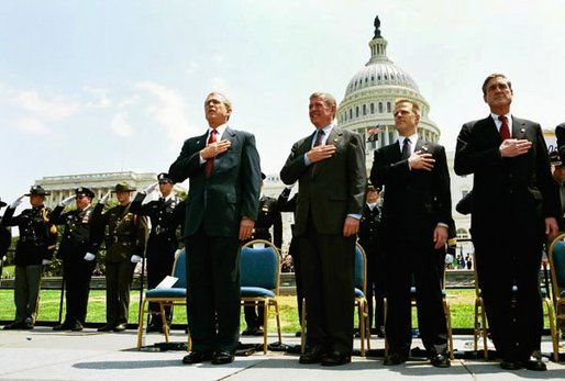 "President George W. Bush attends the Annual Peace Officers' Memorial Service at the U.S. Capitol in Washington, D.C., Saturday, May 15, 2004. ""Every year on this day, we pause to remember the sacrifice and faithful services of officers lost in the line of duty throughout our nation's history,"" said the President. White House photo by Paul Morse"