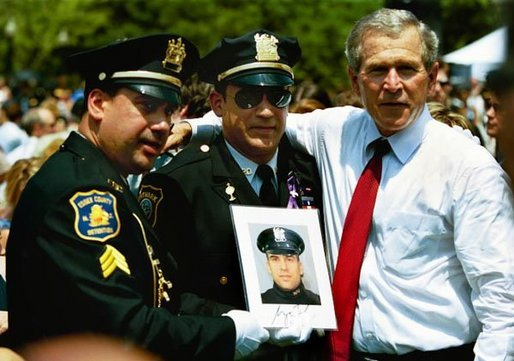 "President George W. Bush stands for pictures during the Annual Peace Officers' Memorial Service at the U.S. Capitol in Washington, D.C., Saturday, May 15, 2004. ""Our fallen officers died in service to justice, and in defense of the innocent,"" said President Bush. ""They will never be forgotten by their comrades, they will never be forgotten by their country."" White House photo by Paul Morse"
