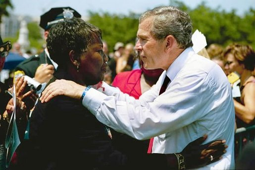 President George W. Bush talks with a woman attending the Annual Peace Officers' Memorial Service at the U.S. Capitol in Washington, D.C., Saturday, May 15, 2004. White House photo by Paul Morse