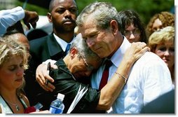 "President George W. Bush hugs a woman attending the Annual Peace Officers' Memorial Service at the U.S. Capitol in Washington, D.C., Saturday, May 15, 2004. ""I also thank all the family members who have come to Washington for this service. For each of you, there is a name on the National Law Enforcement Officers Memorial that will always stand apart. You feel the hurt of loss and separation, but I hope that you don't feel alone,"" said the President.  White House photo by Paul Morse"