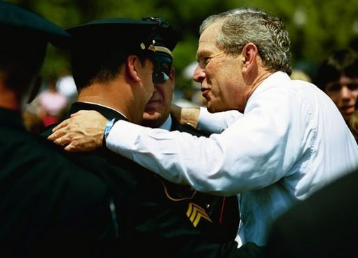 "President George W. Bush talks with officers at the Annual Peace Officers' Memorial Service at the U.S. Capitol in Washington, D.C., Saturday, May 15, 2004. ""In the Memorial, and in countless acts of love and kindness, the fallen are remembered and honored. And this afternoon, on behalf of all Americans, I offer the respect of a grateful nation,"" said the President. ""Their calling in life was to keep the peace."" White House photo by Paul Morse"