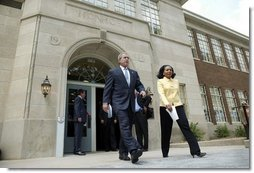 President George W. Bush and Cheryl Brown Henderson, President and CEO of Brown Foundation for Educational Equity, Excellence and Research, walk to the stage during the 50th anniversary of Brown V. Board of Education at the National Historic Site named in its honor in Topeka, Kan., Monday, May 17, 2004.  White House photo by Eric Draper