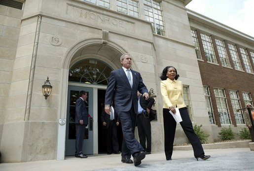 President George W. Bush and Cheryl Brown Henderson, President and CEO of Brown Foundation for Educational Equity, Excellence and Research, walk to the stage during the 50th anniversary of Brown V. Board of Education at the National Historic Site named in its honor in Topeka, Kan., Monday, May 17, 2004. White House photo by Eric Draper.