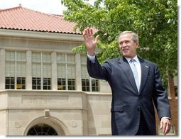 President George W. Bush waves to the audience before delivering remarks during the 50th anniversary of Brown V. Board of Education at the national historic site named in its honor in Topeka, Kan., Monday, May 17, 2004.  White House photo by Eric Draper