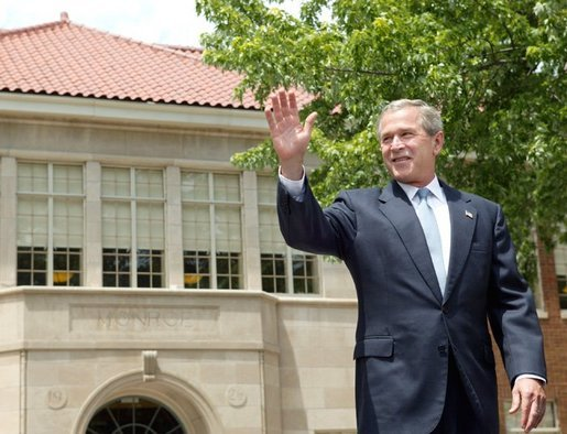 President George W. Bush waves to the audience before delivering remarks during the 50th anniversary of Brown V. Board of Education at the national historic site named in its honor in Topeka, Kan., Monday, May 17, 2004. White House photo by Eric Draper.