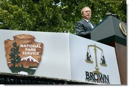 "President George W. Bush talks about segregation during the 50th anniversary of Brown V. Board of Education at the national historic site named in its honor in Topeka, Kan., Monday, May 17, 2004. ""The color of your skin determined where you could get your hair cut, which hospital ward you could be treated in, which park or library you could visit, or who you could go fishing with. And children were instructed early in the customs of racial division -- at schools where they never saw a face of another color,"" said the President.  White House photo by Eric Draper"