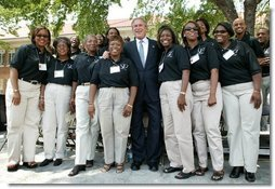 President George W. Bush poses for a photograph with the 16th Street Baptist Church Choir of Birmingham, Ala., at the Brown V. Board of Education National Historic Site in Topeka, Kan., Monday, May 17, 2004.  White House photo by Eric Draper